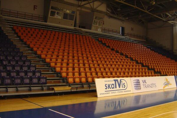 Purple and orange plastic indoor sports seating