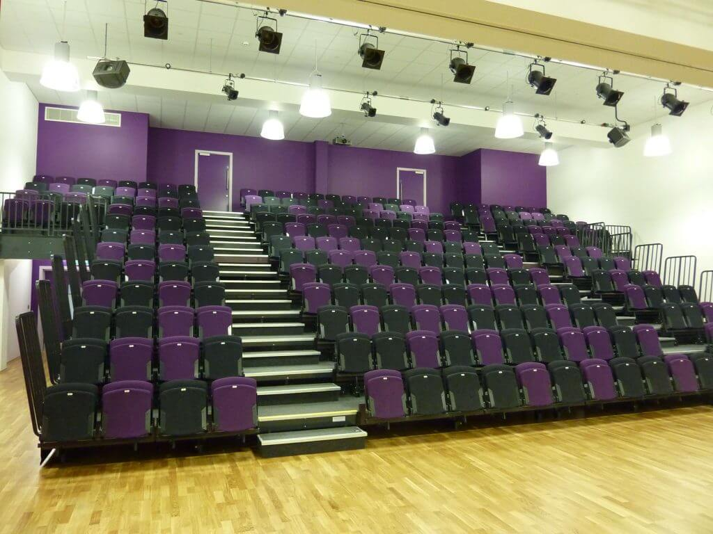 retractable seating manufacturer