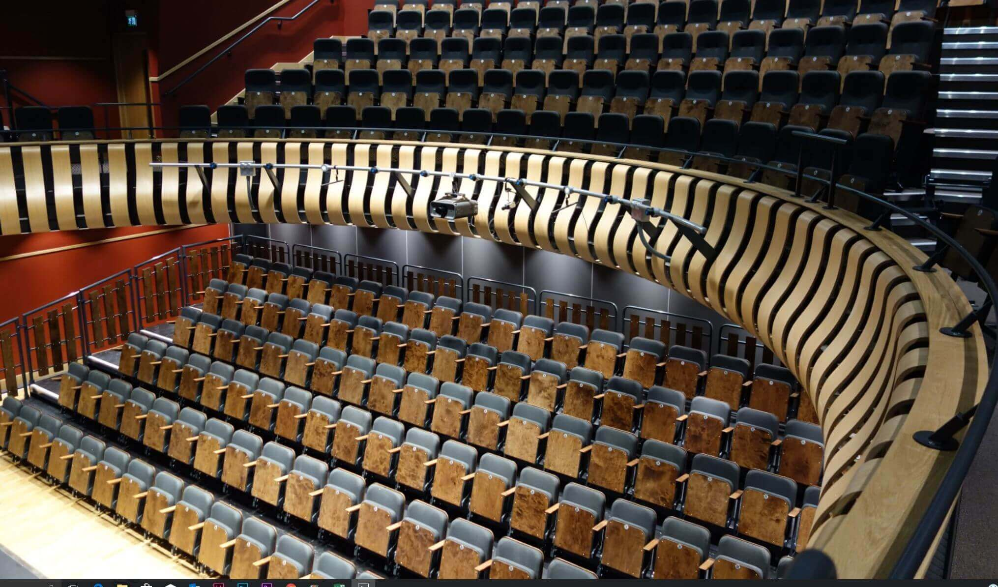 Retractable and theatre seating, Black chairs with wood surrounds