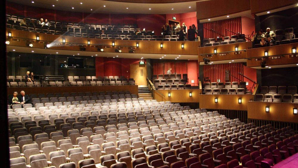 Stage view of light grey theatre seating