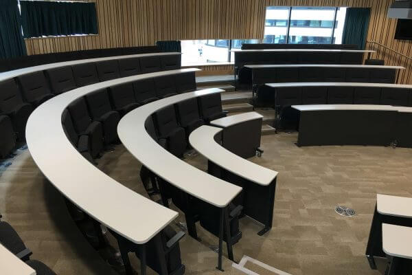 Harvard lecture seating, Black chairs, white writing desks