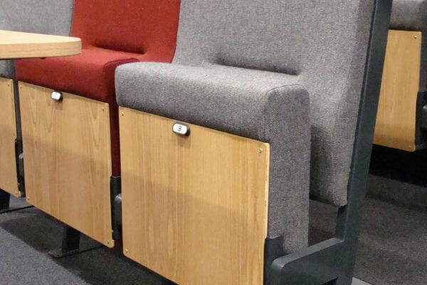 Close up of grey and red lecture theatre seats