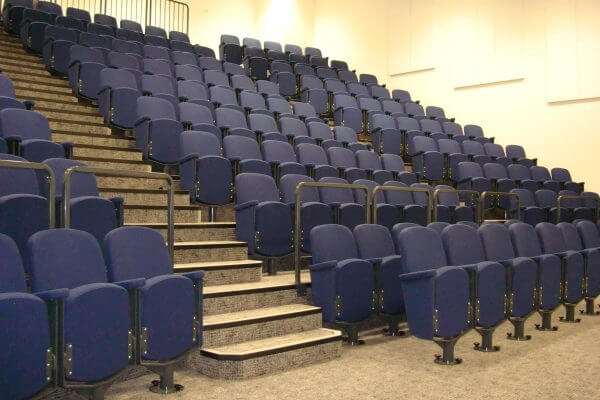 fixed theatre seating, purple seats