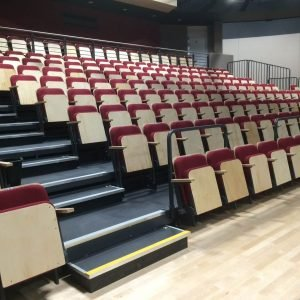 retractable theatre seating, Red chairs with light wood