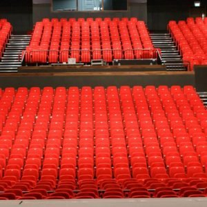 Two tiers of Red retractable and theatre seating