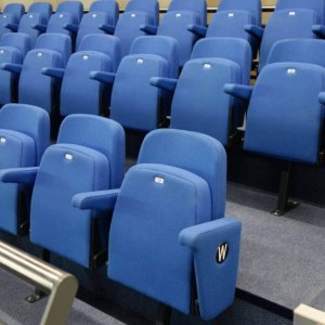 Three rows of blue theatre chairs