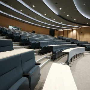 Fixed tier black lecture theatre seating