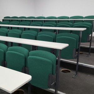 Lecture hall seating with fold able seats in teal blue