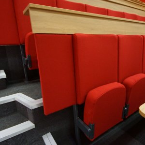 red folding lecture hall chairs with desks