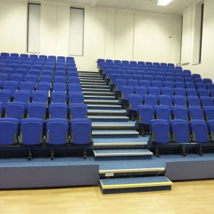 wide angle photo of blue retractable seating for schools and sports halls