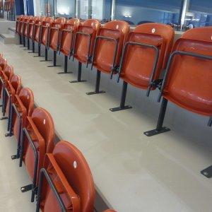 folding metal sports seating in red