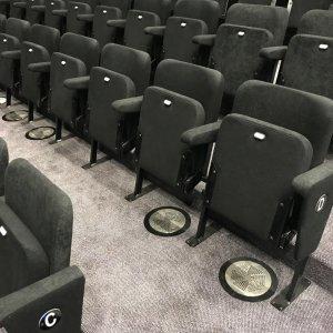 black folded seating with armrests