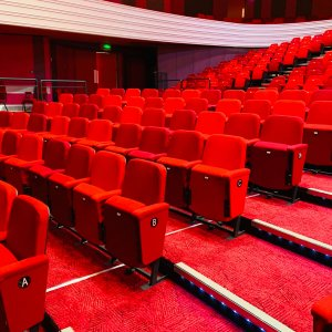 red cinema chairs with red carpet