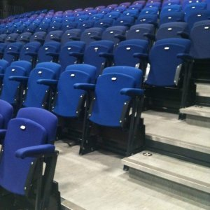 Blue chairs, retractable seating, theatre seating