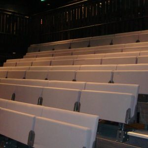 Beige double tip up bench seating, theatre seating, retractable seating