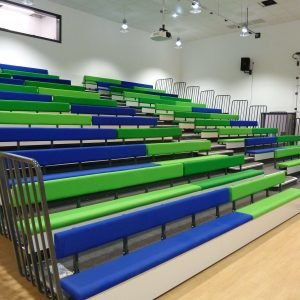 Green and blue upholstered benches with back-rest, retractable seating