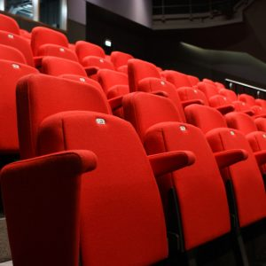 Red theatre chairs, retractable seating, close up