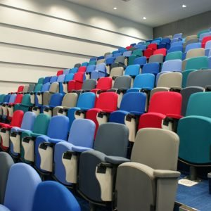 Lecture theatre, Multi-coloured chairs, folding writing tablet,
