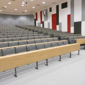Rows of grey lecture theatre seats