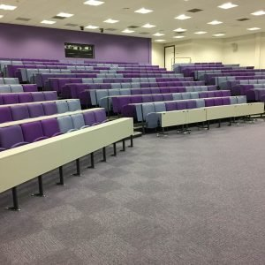 Lecture theatre, Swansea University, Writing desks, purple and grey chairs,