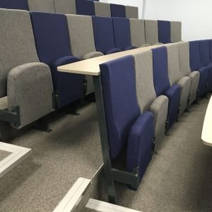 Lecture theatre, Writing desks, Blue and grey chairs, high-backed