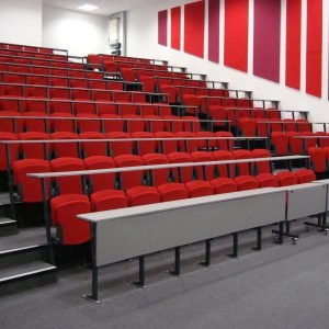 Lecture theatre, Rows of red chairs with attached writing desks
