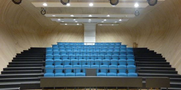 Lecture hall, Rows of blue chairs with writing desks