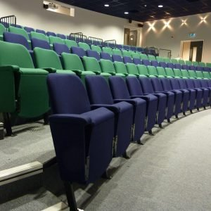 Side view of rows of blue and green chairs