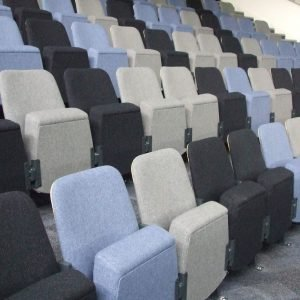 Rows of black, grey and light blue Theatre seats