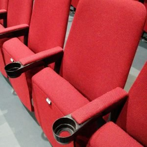 Single red cinema chair, cupholder
