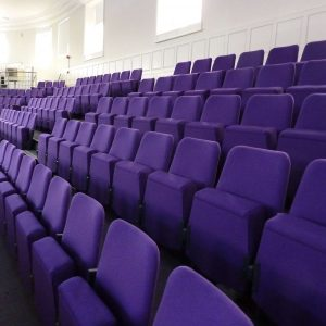 Rows of purple chairs, no arm-rests